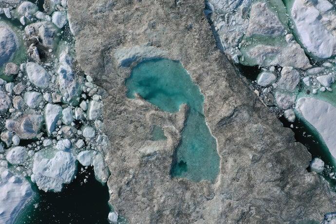 ice forms a lake on free-floating ice jammed into the Ilulissat Icefjord