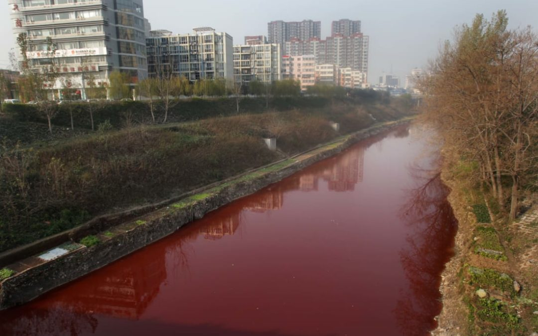 Jian River in Luoyang, China, red from red dye