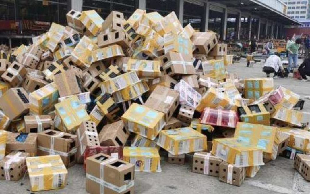 Boxes that had contained live rabbits, guinea pigs, cats and dogs without food or water are seen at the Dongxing Logistics station in Luohe city, in China's Henan province